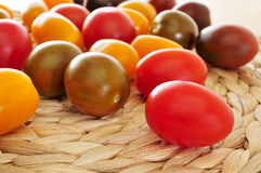 Baby plum tomatoes. Closeup of some baby plum tomatoes of different colors Royalty Free Stock Photography