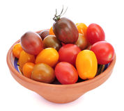 Baby plum tomatoes of different colors Royalty Free Stock Image