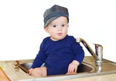 baby plumber repairs water tap Royalty Free Stock Images