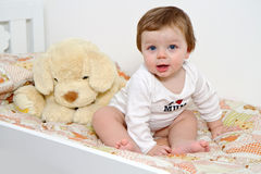 Baby with plush dog Royalty Free Stock Images