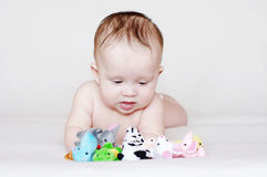 Baby with plush toys Stock Images