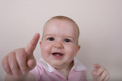 Baby Pointing At Camera Stock Photography