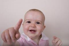 Baby Pointing at Camera Stock Photography