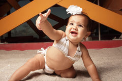 Baby pointing her finger stock photo