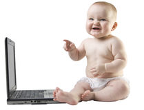 Baby pointing and laughing working on laptop. Stock Images