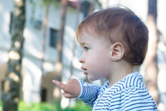 Baby pointing at the park Stock Images