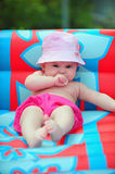 Baby in the pool Royalty Free Stock Image