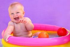 Baby in the pool Stock Image