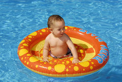 Baby in the pool stock images