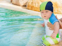 Baby in pool Stock Images