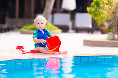 Baby at pool Stock Images