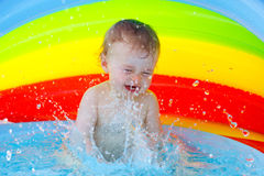 Baby in pool Stock Image