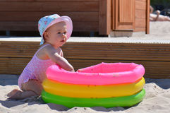 Baby and the pool Stock Photos
