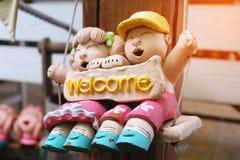 Baby - poppenpaar met ` welkome ` Stock Foto