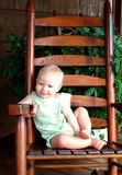 Baby on Porch. Baby boy on rocking chair on front porch of family home Royalty Free Stock Image