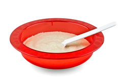 Baby porridge on plate Stock Photo