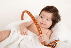 Baby portrait in basket with white towel Stock Photos