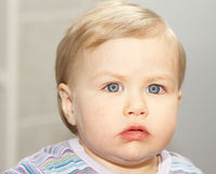 Baby portrait with blue eyes. Baby with blue eyes and fair complexion looking intense Stock Image