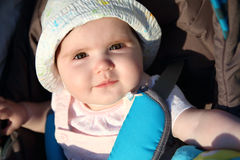 Baby portrait. Close up on baby girl smiling face outdoors Stock Photography