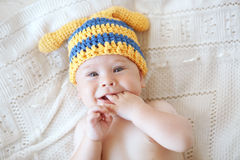 Baby. Portrait of a cute 4 months baby wearing crochet knit hat, top view point Stock Photography