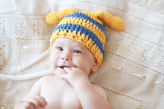 Baby. Portrait of a cute 4 months baby wearing crochet knit hat, top view point Stock Photos