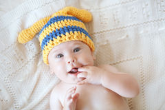 Baby. Portrait of a cute 4 months baby wearing crochet knit hat, top view point Royalty Free Stock Photography