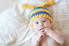 Baby. Portrait of a cute 4 months baby wearing crochet knit hat, top view point Royalty Free Stock Photos