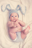 Baby. Portrait of a cute 6 months baby wearing rabbit hat Royalty Free Stock Images