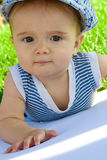 Baby portrait on the grass Royalty Free Stock Photo