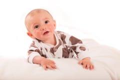 happy little boy on blanket Stock Images