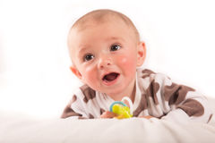 happy little boy on blanket Stock Images