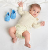 Baby portrait lie on white towel in bed Stock Images