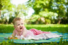 Baby portrait - lying outdoor Royalty Free Stock Image