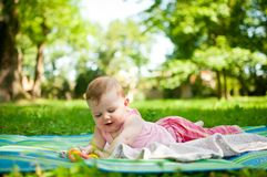 Baby portrait - lying outdoor Royalty Free Stock Photo