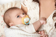 Baby portrait in mother hand, happy maternity concept Stock Image