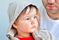 Baby portrait. Portrait of a baby sitting next to his father Royalty Free Stock Photos