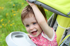 Baby portrait in stroller Royalty Free Stock Images