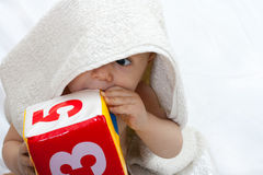 Baby portrait with towel Stock Photography