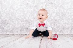 Baby pose with betrothal ring. Lovely baby boy smilling and pose with betrothal ring Stock Photos