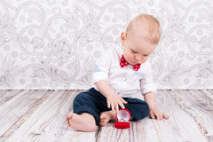Baby pose with brilliant ring. Lovely baby boy pose with betrothal ring Royalty Free Stock Image