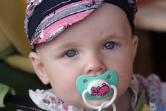 Baby poses with pacifier Stock Photo