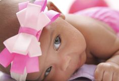 Baby posing on a cloth diaper royalty free stock photos