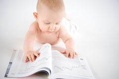 Baby posing to read Stock Photo