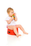 Baby on pot Royalty Free Stock Image