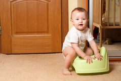 Baby on the pot Royalty Free Stock Images