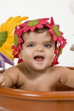 Baby in a pot. A baby is stuck in a pot stock photos