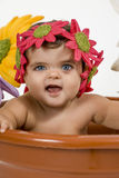 Baby in a pot. A baby is stuck in a pot royalty free stock images