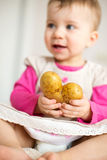 Baby with Potato in Heart Form Stock Photography