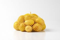 Baby potatoes in netting Stock Photos