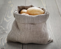 Baby potatoes in sack bag Royalty Free Stock Photography